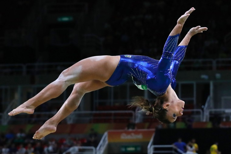 Brazil's Jade Barbosa competes in the Beam event during the women's team final Artistic Gymnastics at the Olympic Arena during the Rio 2016 Olympic Games in Rio de Janeiro on August 9, 2016. (Thomas Coex/AFP/Getty Images)