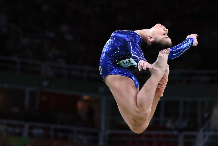 Brazil's Flavia Saraiva competes in the Beam event during the women's team final Artistic Gymnastics at the Olympic Arena during the Rio 2016 Olympic Games in Rio de Janeiro on August 9, 2016. (Thomas Coex/AFP/Getty Images)