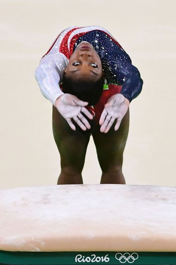 US gymnast Simone Biles competes in the Vault event during the women's team final Artistic Gymnastics at the Olympic Arena during the Rio 2016 Olympic Games in Rio de Janeiro on August 9, 2016. (Emmanuel Dunand/AFP/Getty Images)