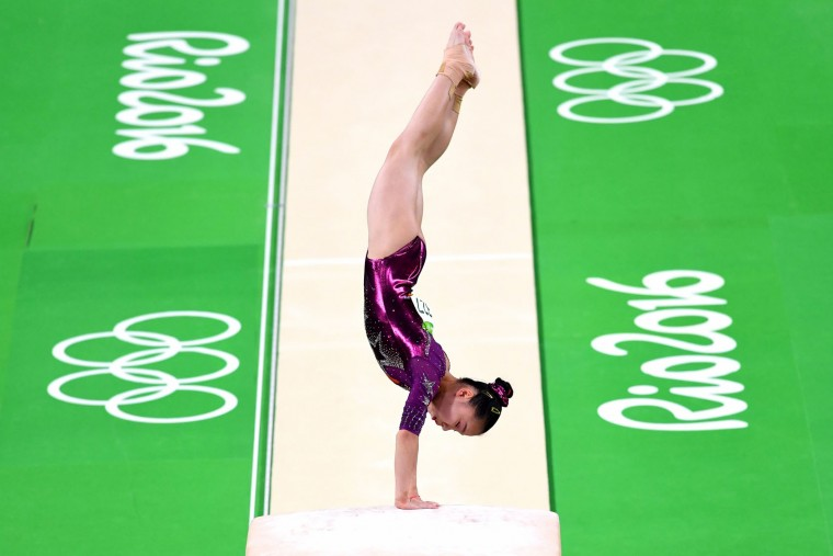 Yan Wang of China competes on the vault during the Artistic Gymnastics Women's Team Final on Day 4 of the Rio 2016 Olympic Games at the Rio Olympic Arena on August 9, 2016 in Rio de Janeiro, Brazil. (Photo by Quinn Rooney/Getty Images)