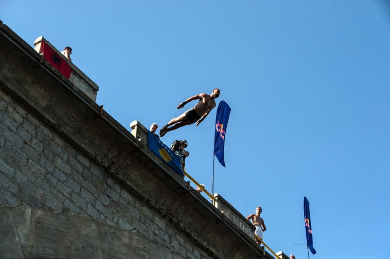 A man jumps from the 22-meter-high bridge Ura during the High Diving competition near the town of Gjakova on July 31, 2016. (ARMEND NIMANI/AFP/Getty Images)