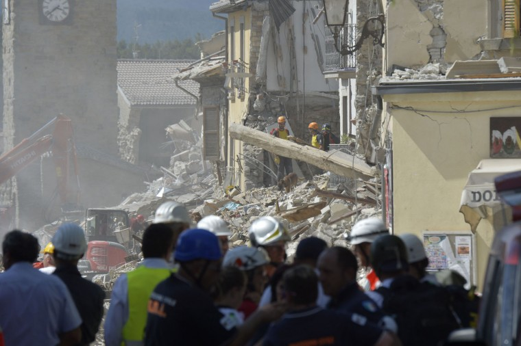 Rescue workers serach through the rubble of an earthquake destroyed building in the central Italian village of Amatrice on August 26, 2016, two day after a 6.2-magnitude earthquake struck the region killing some 267 people. An increasingly forlorn search for victims of the earthquake that brought carnage to central Italy entered a third day on August 26, 2016 as a day of mourning was declared for victims of a disaster that has claimed at least 267 lives. Releasing the new confirmed death toll, Immacolata Postiglione, head of the Civil Protection agency's emergency unit, indicated there had been no survivors found overnight in any of the remote mountain villages devastated by August 24's powerful pre-dawn quake. At least 367 people have been hospitalised with injuries but no one has been pulled alive from the piles of collapsed masonry since August 24 evening. (Andreas Solaro/AFP/Getty Images)