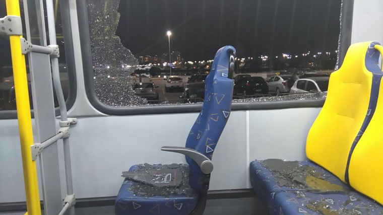 The damages to the window of a Olympic journalists bus hit while driving on the transolympica highway are seen in Rio de Janeiro on August 9, 2016. (GASTON SAINZ/AFP/Getty Images)