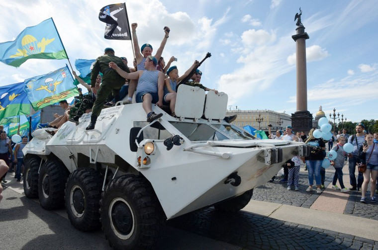 Former Russian soldiers of the airborne forces ride an APC as they celebrate Paratroopers' Day in central Saint Petersburg on August 2, 2016. (Olga Maltseva/AFP/Getty Images)