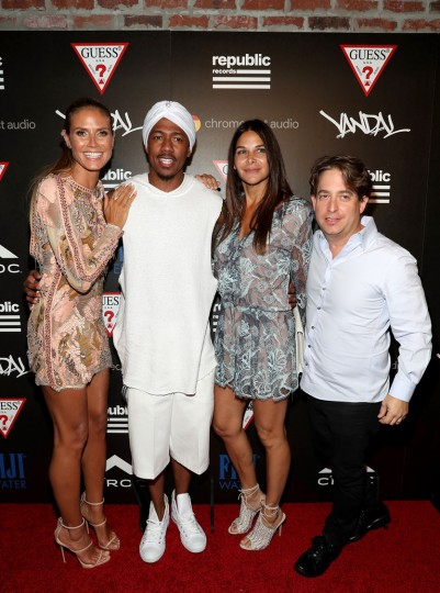 (L-R) Heidi Klum, Nick Cannon, guest, and Charlie Walk attend a celebration with Republic Records and Guess after the 2016 MTV Video Music Awards at Vandal with cocktails by Ciroc on August 28, 2016 in New York City. (Photo by Rob Kim/Getty Images for Republic Records)