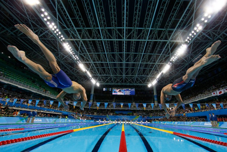 (L-R) Michael Phelps and Ryan Lochte of the United States compete in the second Semifinal of the Men's 200m Individual Medley on Day 5 of the Rio 2016 Olympic Games at the Olympic Aquatics Stadium on August 10, 2016 in Rio de Janeiro, Brazil. (Photo by Al Bello/Getty Images)