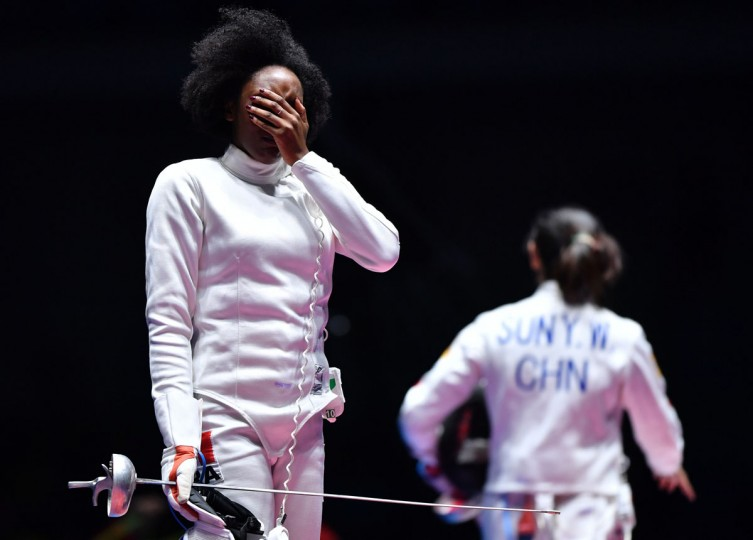 France's Lauren Rembi reacts after losing to China's Sun Yiwen (R) in the womens individual epee bronze medal bout as part of the fencing event of the Rio 2016 Olympic Games, on August 6, 2016, at the Carioca Arena 3, in Rio de Janeiro. (AFP PHOTO / Fabrice COFFRINI)