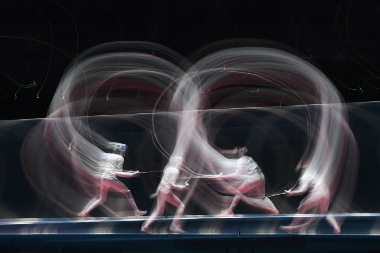 A multi exposure picture shows Hungary's Emese Szasz (R) competing against France's Lauren Rembi during their womens individual epee semi-final bout as part of the fencing event of the Rio 2016 Olympic Games, on August 6, 2016, at the Carioca Arena 3, in Rio de Janeiro. (AFP PHOTO / Kirill KUDRYAVTSEV)