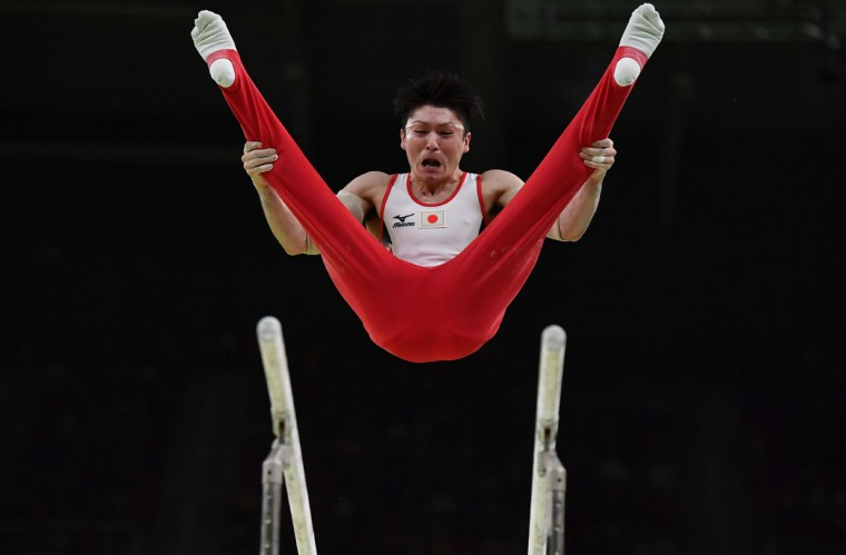 Japan's Kohei Uchimura competes in the qualifying for the men's parallel bars event of the Artistic Gymnastics at the Olympic Arena during the Rio 2016 Olympic Games in Rio de Janeiro on August 6, 2016. (AFP PHOTO / Ben STANSALL)