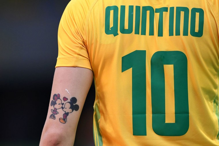 A tattoo depicting Mickey Mouse and Minnie is picture on the arm of Brazil's right wing Jessica Quintino during the women's preliminaries Group A handball match Norway vs Brazil for the Rio 2016 Olympics Games at the Future Arena in Rio on August 6, 2016. (AFP PHOTO / FRANCK FIFE)