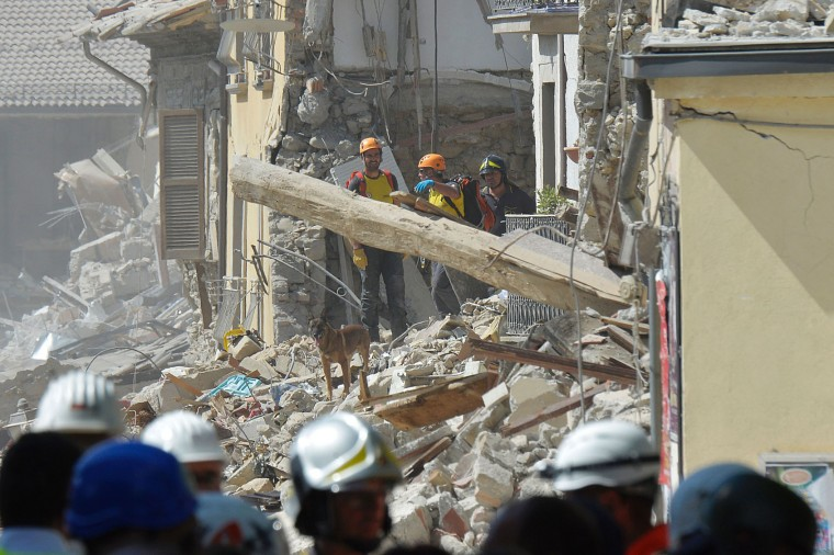 Rescue workers search through the rubble of an earthquake damaged building in the central Italian village of Amatrice on August 26, 2016, two day after a 6.2-magnitude earthquake struck the region killing some 267 people. An increasingly forlorn search for victims of the earthquake that brought carnage to central Italy entered a third day on August 26, 2016 as a day of mourning was declared for victims of a disaster that has claimed at least 267 lives. Releasing the new confirmed death toll, Immacolata Postiglione, head of the Civil Protection agency's emergency unit, indicated there had been no survivors found overnight in any of the remote mountain villages devastated by August 24's powerful pre-dawn quake. At least 367 people have been hospitalised with injuries but no one has been pulled alive from the piles of collapsed masonry since August 24 evening. (Andreas Solaro/AFP/Getty Images)