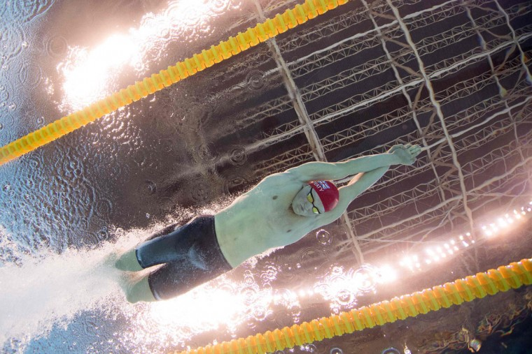 Britain's Adam Peaty competes to break the world record in the Men's 100m Breaststroke heat during the swimming event at the Rio 2016 Olympic Games at the Olympic Aquatics Stadium in Rio de Janeiro on August 6, 2016. (AFP PHOTO / Francois-Xavier Marit)