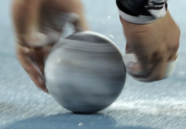 An unidentified shot putter chalks a shot prior to the men's shot put final during the athletics competitions of the 2016 Summer Olympics at the Olympic stadium in Rio de Janeiro, Brazil, Thursday, Aug. 18, 2016. (AP Photo/Matt Slocum)