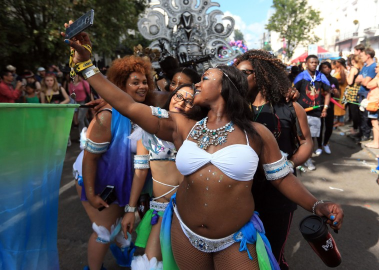 Dancers from the ELIMU float parade down Chepstow Road, during the second and final day of the Notting Hill Carnival, in London, Monday Aug. 29, 2016. (Jonathan Brady/PA via AP)
