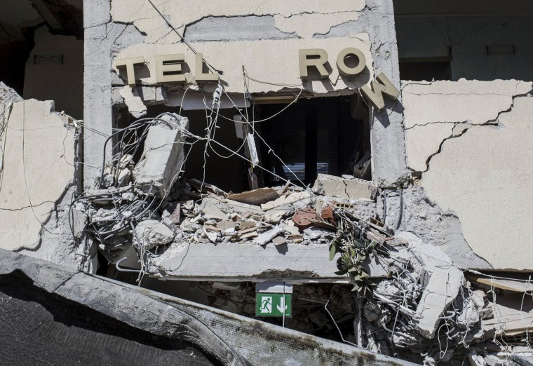 This picture taken on Wednesday, Aug. 24, 2016 shows the crumbling hulk of the Hotel Roma in Amatrice, central Italy, where a strong quake had hit a few hours earlier. Strong aftershocks rattled residents and rescue crews alike Friday, Aug. 26, 2016, as hopes began to dim that firefighters would find any more survivors from Italy's earthquake. (Massimo Percossi/ANSA via AP)