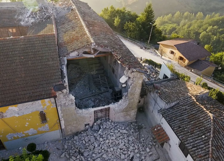 Aerial view of the church of Santa Maria della Misericordia in Accumoli in central Italy, Friday, Aug. 26, 2016, where a strong quake hit early Wednesday. Strong aftershocks rattled residents and rescue crews alike Friday as hopes began to dim that firefighters would find any more survivors as donations began pouring into the area and Italy again anguished over its failure to protect ancient towns and modern cities from the country's highly seismic terrain. (AP Photo/Localteam)