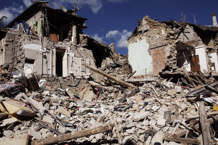 A view of collapsed houses in Accumoli, central Italy, Friday, Aug. 26, 2016, two days after an earthquake. Strong aftershocks rattled residents and rescue crews alike Friday as hopes began to dim that rescuers would find any more survivors from Italy's earthquake. (Roberto Salomone/ANSA via AP)