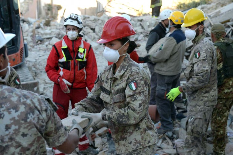 Italian army soldiers clear rubble in Amatrice, central Italy, Friday, Aug. 26, 2016, two days after an earthquake. Strong aftershocks damaged two key access roads into quake-struck Amatrice on Friday, threatening to isolate the tiny hilltop town as hopes dimmed that rescuers would find any more survivors from the earthquake that killed leveled three towns Wednesday. (Italian Army via AP)