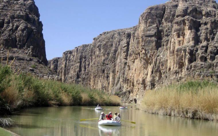 FILE - In this March 25, 2011, file photo, rafts piloted by guides from Far Flung Outdoor Center of Terlingua, Texas, emerge from Heath Canyon, carved by the Rio Grande through Big Bend National Park, Texas. The National Park Service is celebrating its 100th birthday on Thursday, Aug. 25, 2016. (AP Photo/Michael Graczyk, File)