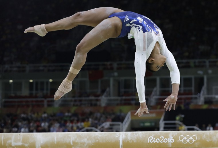 Britain's Elissa Downie performs on the balance beam during the artistic gymnastics women's team final at the 2016 Summer Olympics in Rio de Janeiro, Brazil, Tuesday, Aug. 9, 2016. (AP Photo/Rebecca Blackwell)