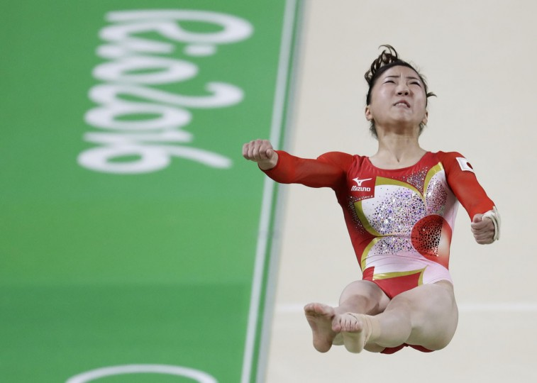 Japan's Asuka Teramoto performs on the vault during the artistic gymnastics women's team final at the 2016 Summer Olympics in Rio de Janeiro, Brazil, Tuesday, Aug. 9, 2016. (AP Photo/Dmitri Lovetsky)