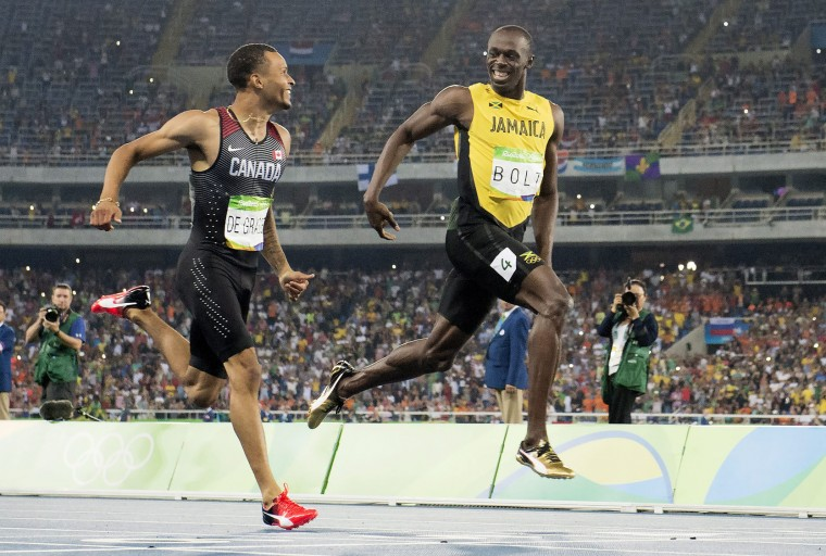 Canada's Andre De Grasse, left, and Jamaica's Usain Bolt smile at the finish line in the semifinal of the men's 200 meters at the Olympic Games in Rio de Janeiro, Brazil, Wednesday, Aug. 17, 2016. (Frank Gunn/The Canadian Press via AP)