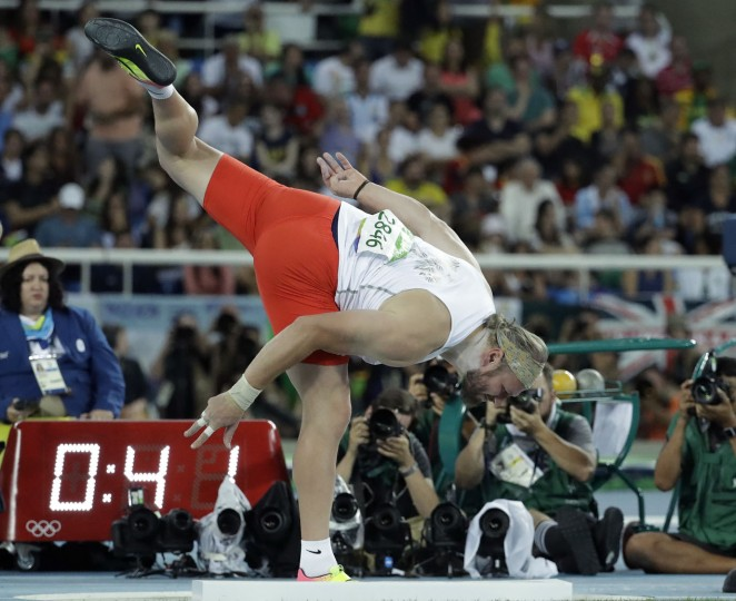 Poland's Tomasz Majewski makes an attempt in the men's shot put final during the athletics competitions of the 2016 Summer Olympics at the Olympic stadium in Rio de Janeiro, Brazil, Thursday, Aug. 18, 2016. (AP Photo/Matt Dunham)