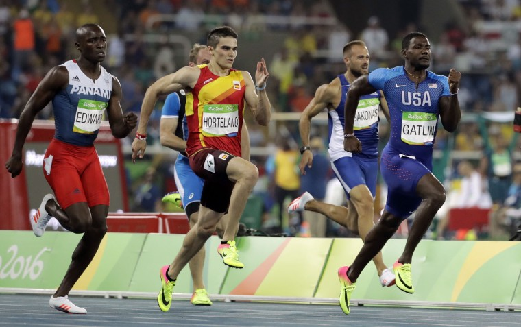 United States' Justin Gatlin, right, and Spain's Bruno Hortelano, center, compete in a men's 200-meter semifinal during the athletics competitions of the 2016 Summer Olympics at the Olympic stadium in Rio de Janeiro, Brazil, Wednesday, Aug. 17, 2016. (AP Photo/Jae C. Hong)