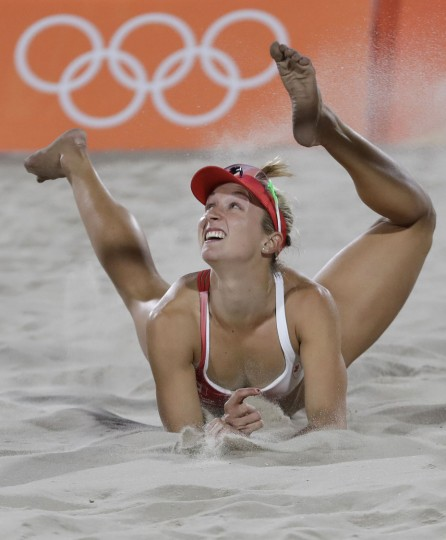 Canada's Heather Bansley looks up after diving for a ball during a women's beach volleyball match against Germany at the 2016 Summer Olympics in Rio de Janeiro, Brazil, Thursday, Aug. 11, 2016. (AP Photo/Petr David Josek)