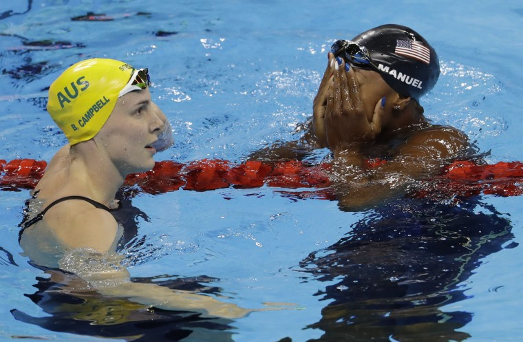 United States' Simone Manuel, right, wins the gold medal setting a new Olympic record in the women's 100-meter freestyle as Australia's Bronte Campbell looks on during the swimming competitions at the 2016 Summer Olympics, Thursday, Aug. 11, 2016, in Rio de Janeiro, Brazil. (AP Photo/Natacha Pisarenko)