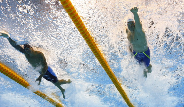 United States' Anthony Ervin, left, and Ukraine's Andrii Govorov (Andriy Hovorov) compete in a semifinal of the men's 50-meter freestyle during the swimming competitions of the 2016 Summer Olympics in Rio de Janeiro, Brazil, Thursday, Aug. 11, 2016. (AP Photo/Lee Jin-man)