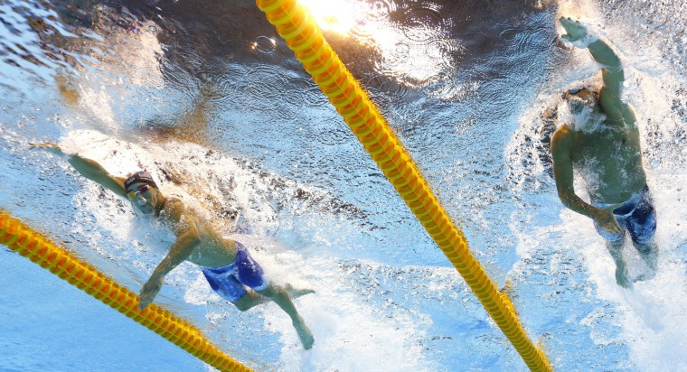 United States' Michael Phelps, left, and Ryan Lochte compete in a semifinal of the men's 200-meter individual medley during the swimming competitions at the 2016 Summer Olympics in Rio de Janeiro, Brazil, Wednesday, Aug. 10, 2016. (AP Photo/David J. Phillip)
