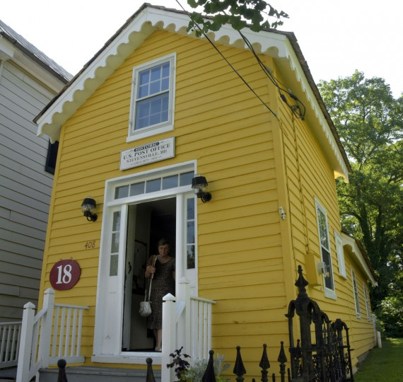 Nancy Cook, chair of the Historic Stevensville Arts & Entertainment District, and docent who gives tours of historic buildings in Stevensville, is pictured in the doorway of the old Stevensville Post Office. According to The Kent Island Heritage Society, Inc., the building served as the post office for the first half of the 20th century. Along with other historical sites in Stevensville, the post office is open the first Saturdays of the month from May to October. (Algerina Perna/Baltimore Sun)