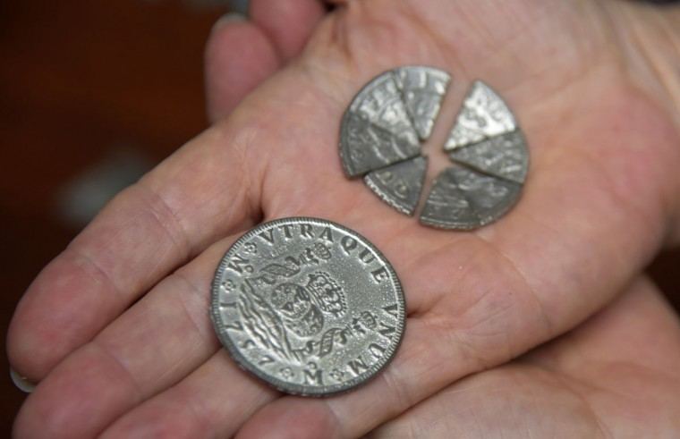 Displayed in the Cray house, the oldest house in Stevensville built in 1809, are Spanish coins, cut into pieces of eight, and used in playing card games. (Algerina Perna/Baltimore Sun)