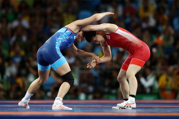 Helen Louise Maroulis of the United States (blue) competes against Saori Yoshida of Japan during the Women's Freestyle 53 kg Gold medal match on Day 13 of the Rio 2016 Olympic Games at Carioca Arena 2 on August 18, 2016 in Rio de Janeiro, Brazil. (Photo by Julian Finney/Getty Images)