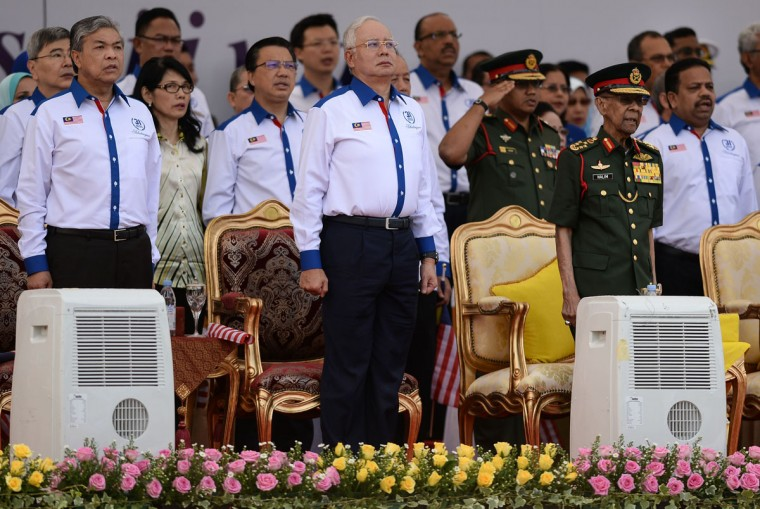 From left: Malaysian Deputy Prime Minister Ahmad Zahid Hamidi, Malaysia's Prime Minister Najib Razak, and Malaysia's King Abdul Halim Mu'adzam Shah observe the national anthem during the 59th National Day celebrations at Independence Square in Kuala Lumpur on August 31, 2016. Malaysia celebrated its 59th National Day to commemorate the independence of the Federation of Malaya from British rule in 1957. (MOHD RASFAN/AFP/Getty Images)
