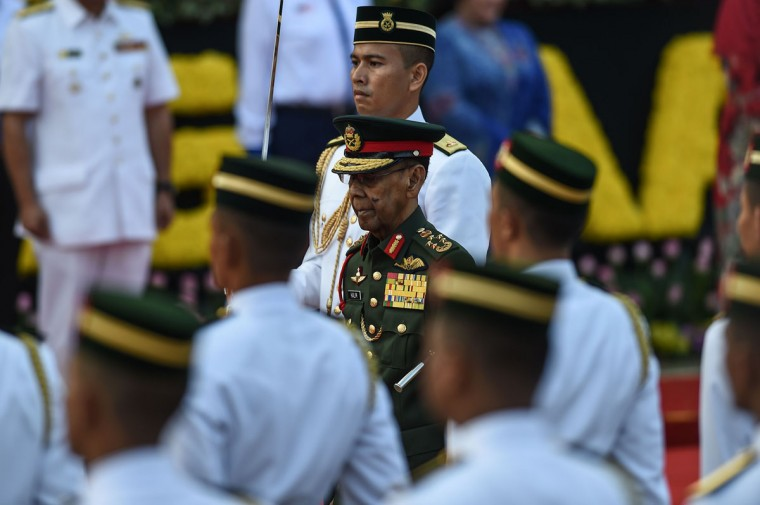 Malaysia's King Abdul Halim Mu'adzam Shah (center) inspects a guard of honor during the 59th National Day celebrations at Independence Square in Kuala Lumpur on August 31, 2016. Malaysia celebrated its 59th National Day to commemorate the independence of the Federation of Malaya from British rule in 1957. (MOHD RASFAN/AFP/Getty Images)