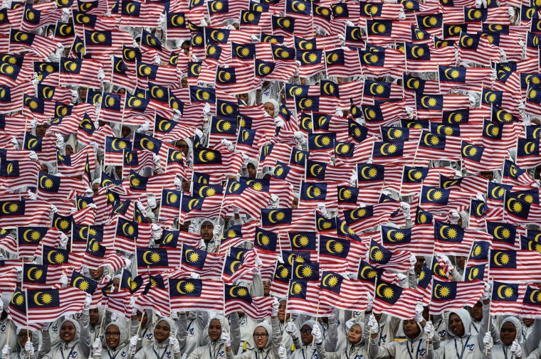 Malaysian schoolchildren wave national flags during the 59th National Day celebrations at Independence Square in Kuala Lumpur on August 31, 2016. Malaysia celebrated its 59th National Day to commemorate the independence of the Federation of Malaya from British rule in 1957. (MOHD RASFAN/AFP/Getty Images)
