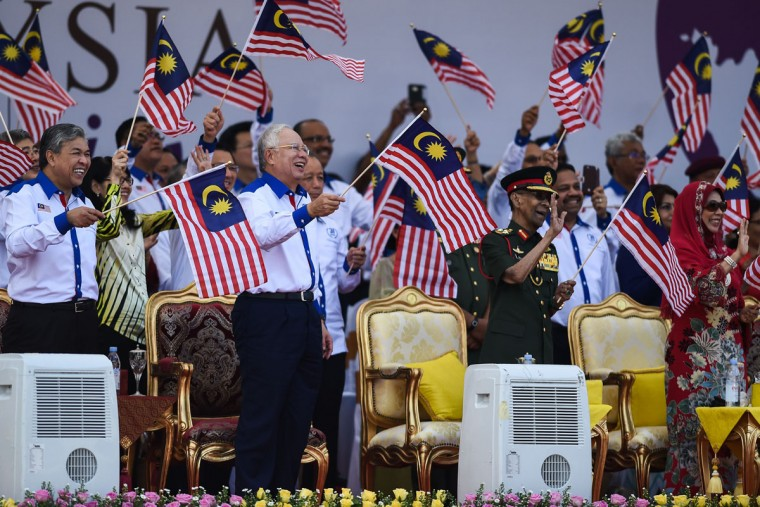 From front left: Malaysia's Deputy Prime Minister Ahmad Zahid Hamidi, Malaysia's Prime Minister Najib Razak, Malaysia's King Abdul Halim Mu'adzam Shah and Queen Haminah Hamidun wave national flags during the 59th National Day celebrations at Independence Square in Kuala Lumpur on August 31, 2016. Malaysia celebrated its 59th National Day to commemorate the independence of the Federation of Malaya from British rule in 1957. (MOHD RASFAN/AFP/Getty Images)
