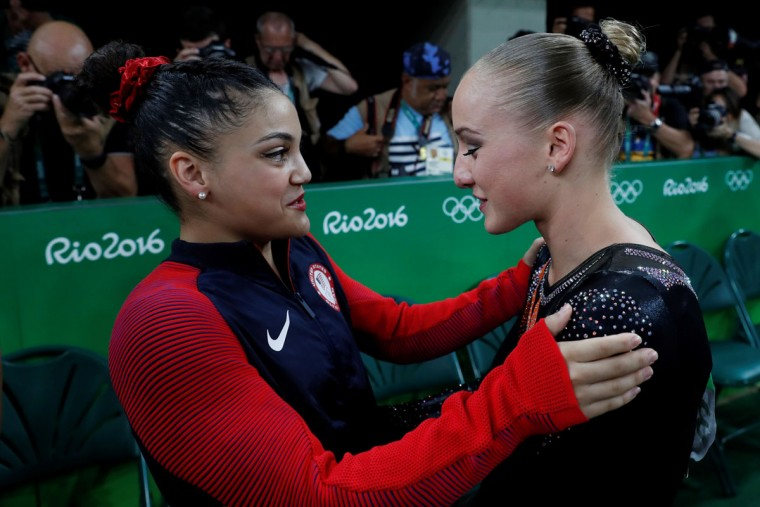 Netherlands' Sanne Wevers celebrates with US gymnast Laurie Hernandez after winning the women's balance beam event final of the Artistic Gymnastics at the Olympic Arena during the Rio 2016 Olympic Games in Rio de Janeiro on August 15, 2016. (THOMAS COEX/AFP/Getty Images)