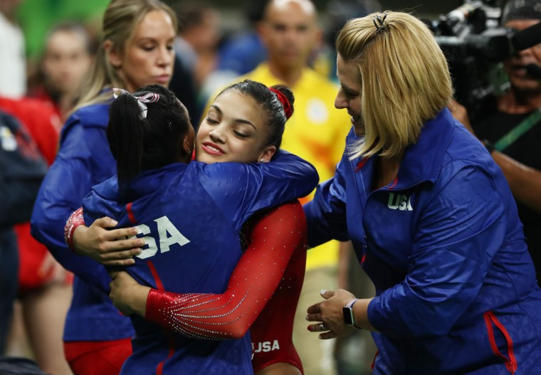 Laurie Hernandez of the United States is congratulated by Simone Biles after competing in the Balance Beam Final on day 10 of the Rio 2016 Olympic Games at Rio Olympic Arena on August 15, 2016 in Rio de Janeiro, Brazil. (Photo by Lars Baron/Getty Images)