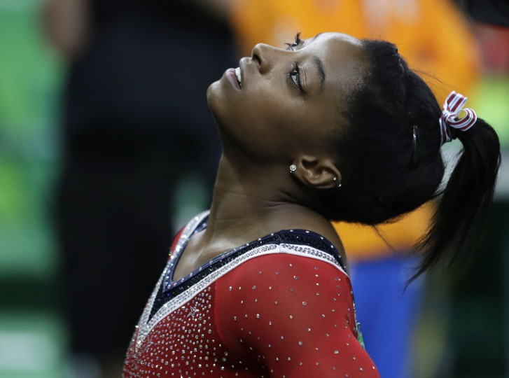 United States' Simone Biles looks at the scoreboard after her balance beam routine during the artistic gymnastics women's apparatus final at the 2016 Summer Olympics in Rio de Janeiro, Brazil, Monday, Aug. 15, 2016. (AP Photo/Rebecca Blackwell)