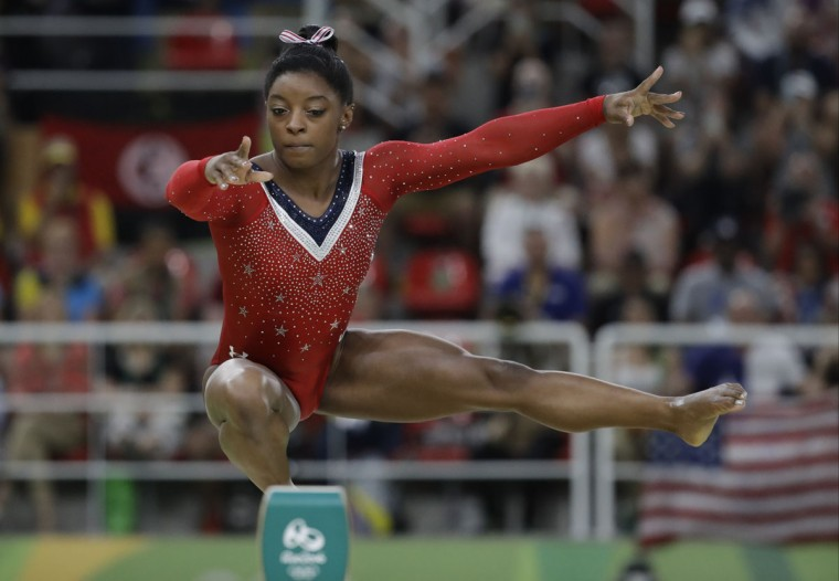 United States' Simone Biles performs on the balance beam during the artistic gymnastics women's apparatus final at the 2016 Summer Olympics in Rio de Janeiro, Brazil, Monday, Aug. 15, 2016. (AP Photo/Julio Cortez)