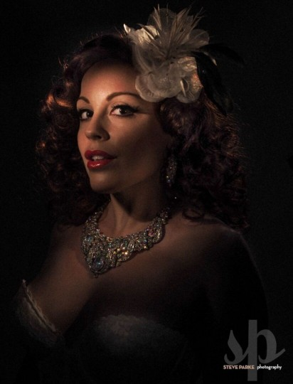 "Baltimore burlesque dancer Ruby Rockafella poses as legendary stripper Blaze Starr. Parke, who has previously worked with Prince, studied vintage pinups to perfect the lighting for the retro-inspired shoot. ""I really had to study the lighting to try to get as close to that as possible."" (Photo by Steve Parke)"
