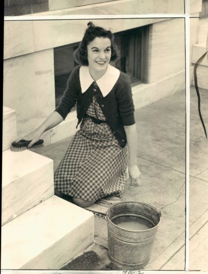 June 6, 1948- BALTIMORE CITY SCENES-- Dorothy Rolley at 227 N. Linwood Avenue washes marble steps to her home. Photo by Sun Staff Photographer.