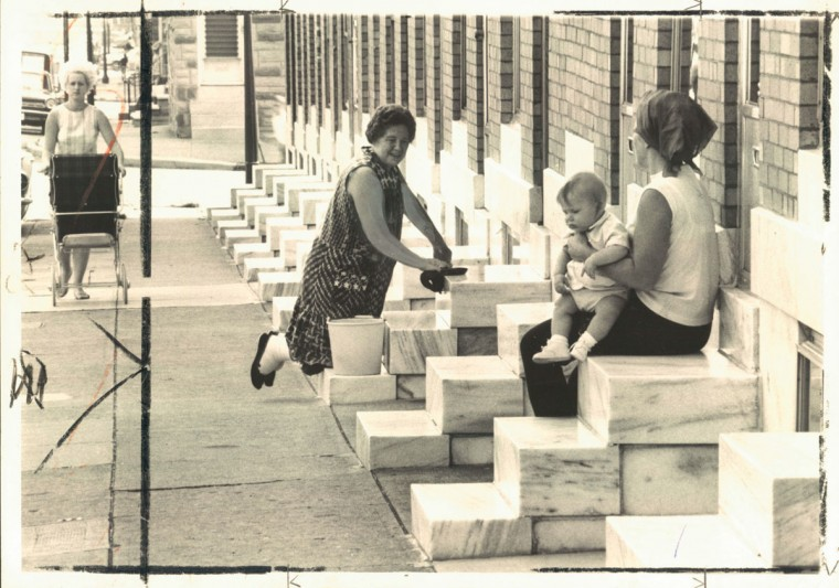 September 16, 1969: Social event--Mrs. Isabella Martin chats with a baby-sitting neighbor, Mrs. Ginny Mayfield, as part of the tradition of marble step-scrubbing in the Highlandtown section. (Hutchins/Baltimore Sun)