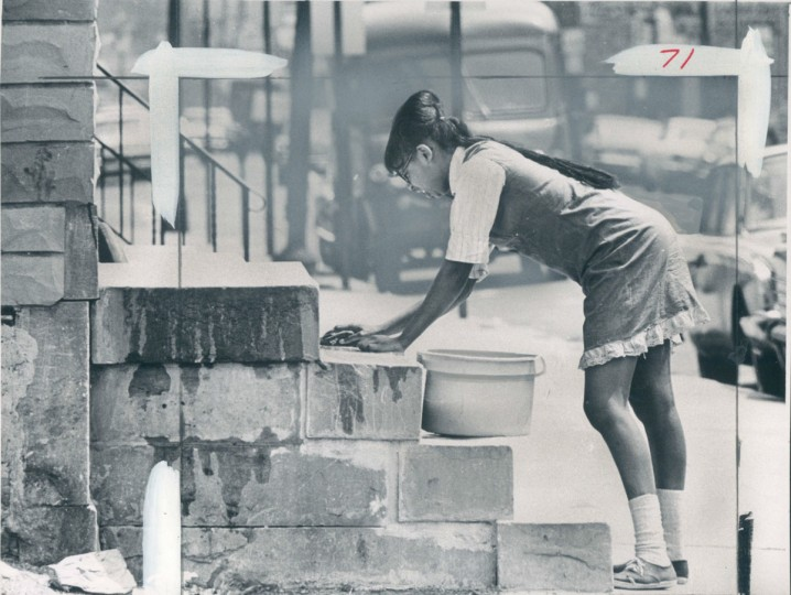 Young woman washing steps on Pennsylvania Avenue, May 10, 1967. (LaForce/Baltimore Sun)