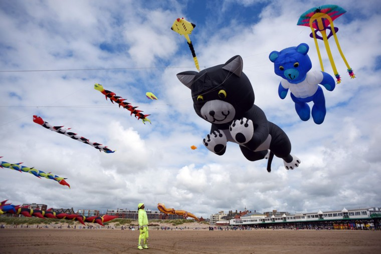 Kite enthusiasts participate in the St Annes Kite Festival on the seafront in Lytham St Annes, north west England on July 30, 2016. (OLI SCARFF/AFP/Getty Images)