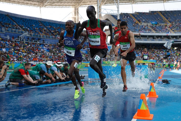 From left, USA's Hillary Bor, Kenya's Brimin Kipruto and ben Tunisia's Amor Ben Yahia compete in the Men's 3000m Steeplechase Final during the athletics event at the Rio 2016 Olympic Games at the Olympic Stadium in Rio de Janeiro on August 17, 2016. (ADRIAN DENNIS/AFP/Getty Images)