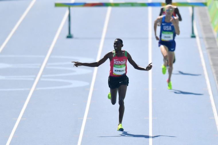 Kenya's Conseslus Kipruto celebrates after he won the Men's 3000m Steeplechase Final during the athletics event at the Rio 2016 Olympic Games at the Olympic Stadium in Rio de Janeiro on August 17, 2016. (PEDRO UGARTE/AFP/Getty Images)